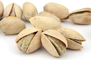 Background White Framed Prints - Pistachios Framed Print by Blink Images
