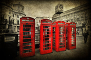 Selective Color Framed Prints - 4 Red Phone Booths Framed Print by Yhun Suarez