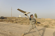 Baghdad Framed Prints - U.s. Army Soldier Launches An Rq-11 Framed Print by Stocktrek Images