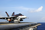 Uss Ronald Reagan Prints - An Fa-18e Super Hornet Launches Print by Stocktrek Images