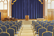 Residential Structure Framed Prints - Auditorium With Blue Chairs And A Stage Framed Print by Douglas Orton