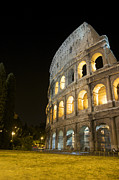 Sites Tapestries Textiles Prints - Coliseum illuminated at night. Rome Print by Bernard Jaubert