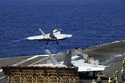 Flight Deck Posters - An Fa-18e Super Hornet Launches Poster by Stocktrek Images