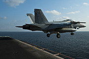 Carrier Posters - An Fa-18f Super Hornet Launches Poster by Stocktrek Images