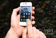 Wireless Technology Posters - Hands Holding An Iphone Poster by Photo Researchers, Inc.