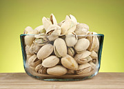 Vegetarian Posters - Pistachios in bowl Poster by Blink Images