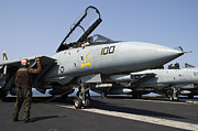 Chained Prints - An F-14d Tomcat On The Flight Deck Print by Gert Kromhout