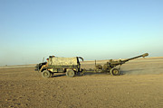 Artillery Metal Prints - A 105mm Light Gun Being Towed Metal Print by Andrew Chittock