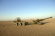 Artillery Metal Prints - A 105mm Light Gun Being Towed By An Metal Print by Andrew Chittock