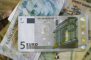 Money Posters - A 5 Euro Bill Is On Top Of A Stack Poster by Stephen Alvarez