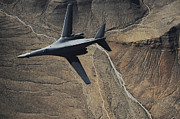 Lancer Framed Prints - A B-1b Lancer Maneuvers Over New Mexico Framed Print by Stocktrek Images