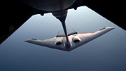 Mechanism Prints - A B-2 Spirit Bomber Conducts Print by Stocktrek Images