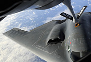 Mechanism Photo Prints - A B-2 Spirit Receives Fuel Print by Stocktrek Images