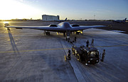 Dragging Posters - A B-2 Spirit Stealth Bomber Is Towed Poster by Stocktrek Images