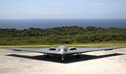 Stealth Prints - A B-2 Spirit Stealth Bomber Waits Print by Stocktrek Images