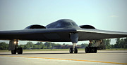 Whiteman Posters - A B-2 Spirit Taxis Onto The Flightline Poster by Stocktrek Images