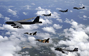 B-52 Framed Prints - A B-52 Stratofortress Leads A Formation Framed Print by Stocktrek Images