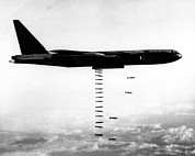 Aerial Photograph Framed Prints - A B-52 Stratofortress Releases Bombs Framed Print by Everett