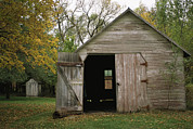 Agricultural Structures Posters - A Barn With An Open Door On Waveland Poster by Joel Sartore