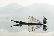 Speculative Prints - A Basket Fisherman Scans Inle Lake Print by Alex Treadway