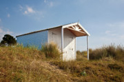 Hut Photo Posters - A Beach hut in the Marram Grass at Old Hunstanton North Norfolk Poster by John Edwards