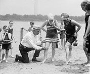1920s Fashion Prints - A Beach Official Checks The Amount Print by Everett