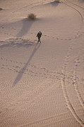 Featured Art - A Bedouin Man Walks Across The Sand by Taylor S. Kennedy