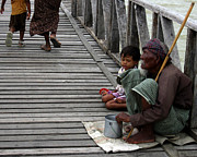 Burma Prints - A beggar on the U Bein Bridge Print by RicardMN Photography