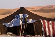 Erg Chebbi Framed Prints - A Berber Tent And Sand Dunes Framed Print by Abraham Nowitz