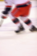 Hockey Player Photos - A blur of Ice Speed by Karol  Livote