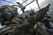 Inflatable Photos - A Boat Crewman Gunner Mans An M-240b by Stocktrek Images
