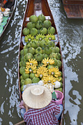 A Boat Laden With Fruit At The Damnoen Saduak Floating Market In Thailand Print by Stefano Baldini