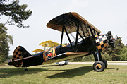 Antique Airplane Prints - A Boeing Stearman N2s-3 Model Biplane Print by Ramon Van Opdorp