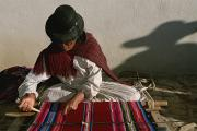 Peoples Framed Prints - A Bolivian Woman Weaves Brightly Framed Print by Kenneth Garrett