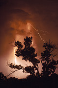 Night Views Prints - A Bolt Of Lightning Brightens A Night Print by Rex A. Stucky