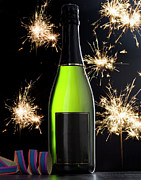 Champagne Posters - A Bottle Of Champagne And Sparklers Poster by Larry Washburn
