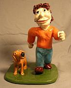 Cartoon Ceramics - A boy and his dog by Bob Dann