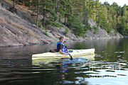 Killarney Provincial Park Prints - A Boy Kayaking Print by Ted Kinsman