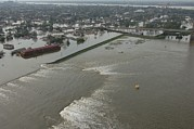 Floods Photos - A Breech In A New Orleans Levee Floods by Everett