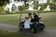 Photography Of Woman Prints - A Bride And Groom Ride On A Golf Cart Print by Joel Sartore
