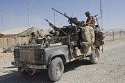 Afghanistan Photo Posters - A British Armed Forces Land Rover Poster by Andrew Chittock