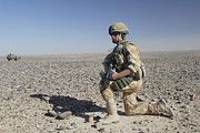 Foot Patrol Photos - A British Army Soldier On A Foot Patrol by Andrew Chittock