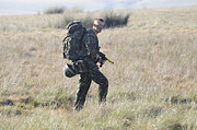 Foot Patrol Photos - A British Army Soldier On Foot Patrol by Andrew Chittock