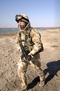 Foot Patrol Photos - A British Army Soldier On Patrol by Andrew Chittock