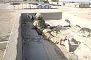 Iraq Prints - A British Soldier Provides Security Print by Andrew Chittock