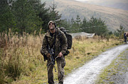 Foot Patrol Photos - A British Soldier With Radio by Andrew Chittock