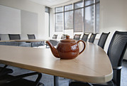 Empty Chairs Posters - A Brown China Teapot On Boardroom Table Poster by Marlene Ford