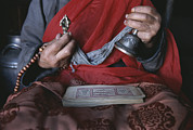 Buddhist Clothing Prints - A Buddhist Lama With Prayer Book Print by Gordon Wiltsie