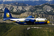 Rock Angels Prints - A C-130 Hercules Fat Albert Plane Flies Print by Stocktrek Images