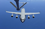 Mechanism Prints - A C-17 Globemaster Iii Approaches Print by Stocktrek Images